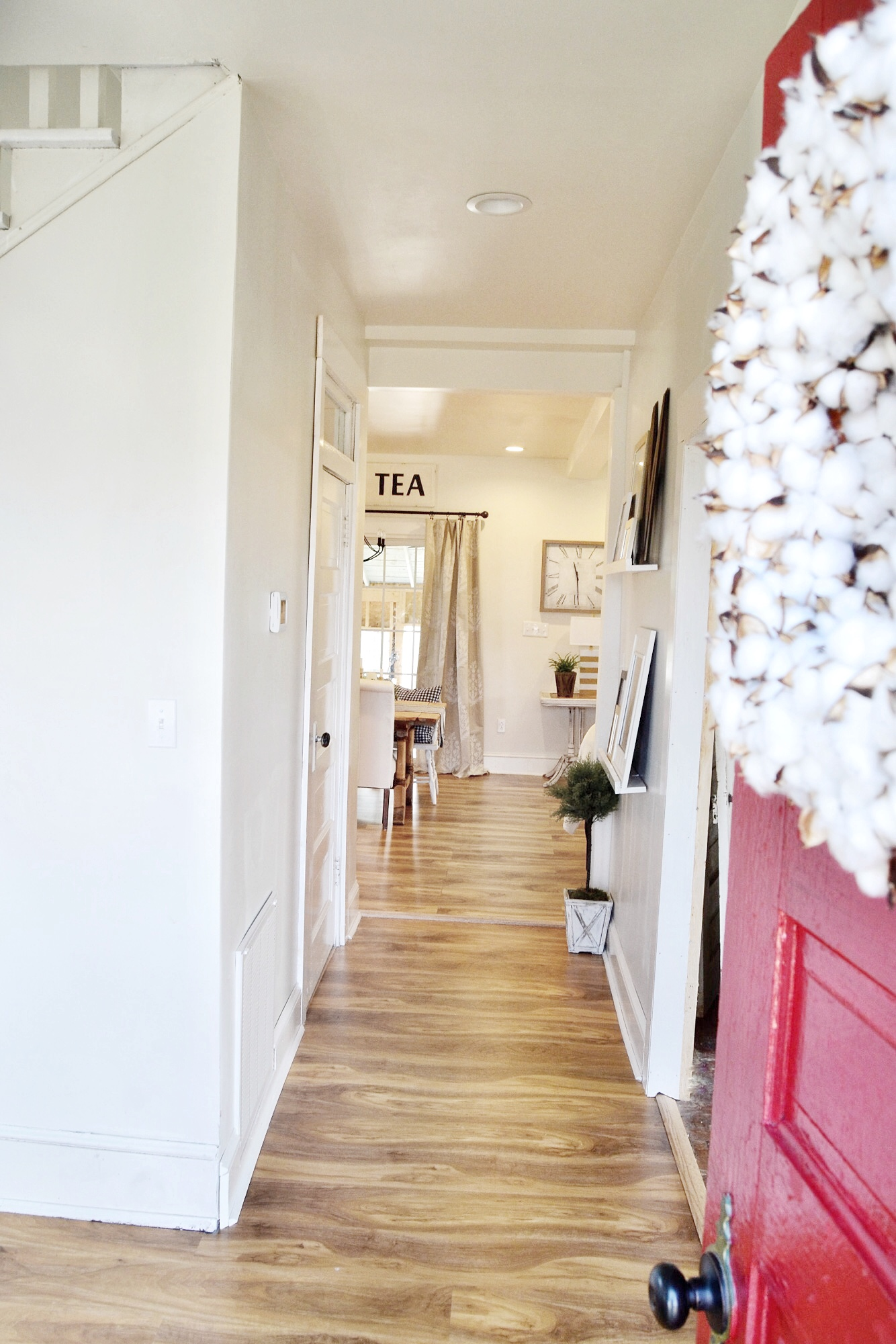 Farmhouse entryway, red door, cotton wreath - The Morris Manor Home Tour