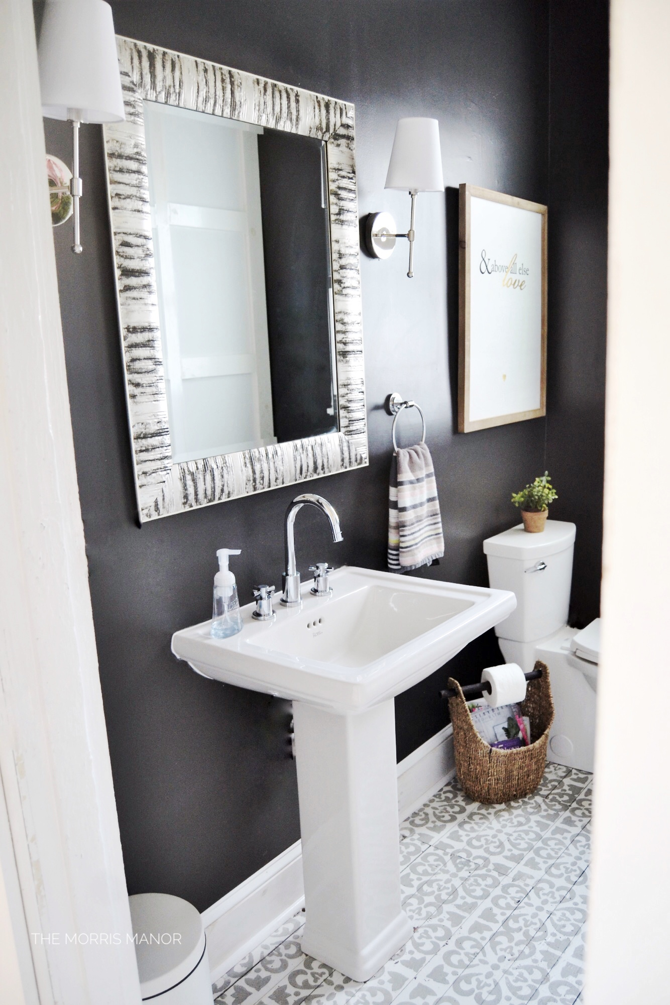 Farmhouse bathroom, black, board grid + batten wall treatment, cement time floor- The Morris Manor Home Tour