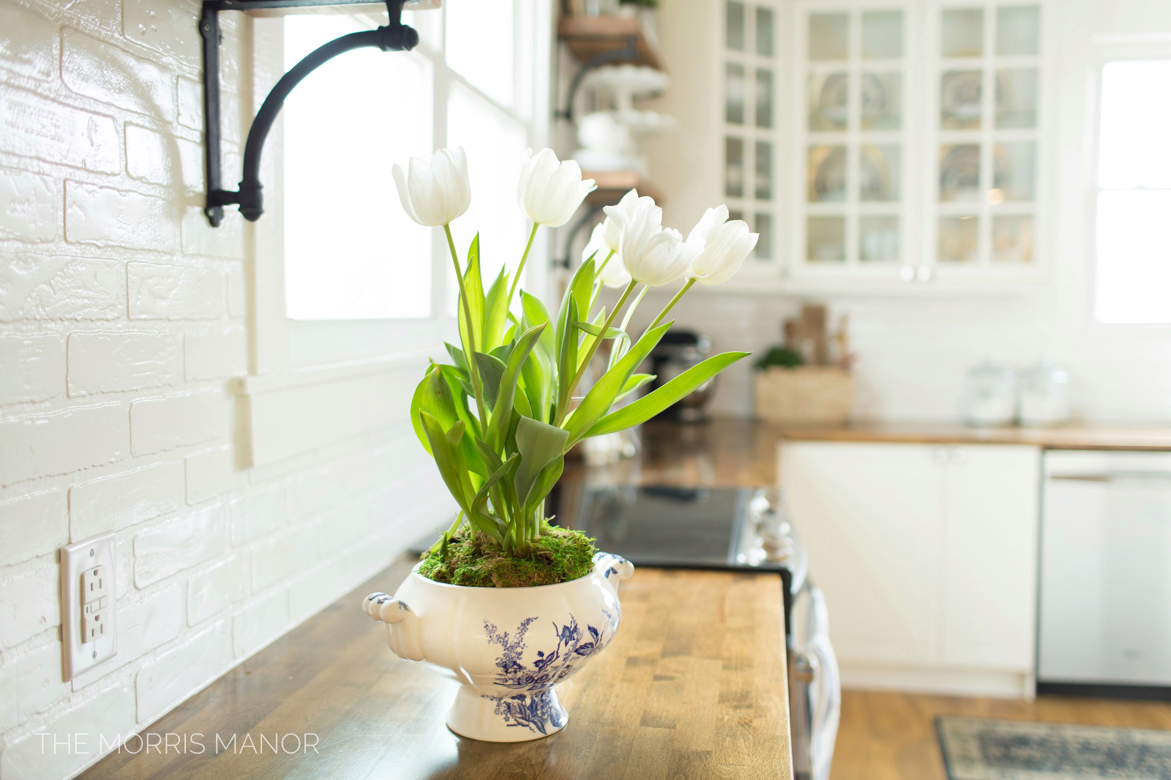The Morris Manor Home Tour - Vintage White Farmhouse Kitchen, White Tulips, Warm Wood Counter Tops