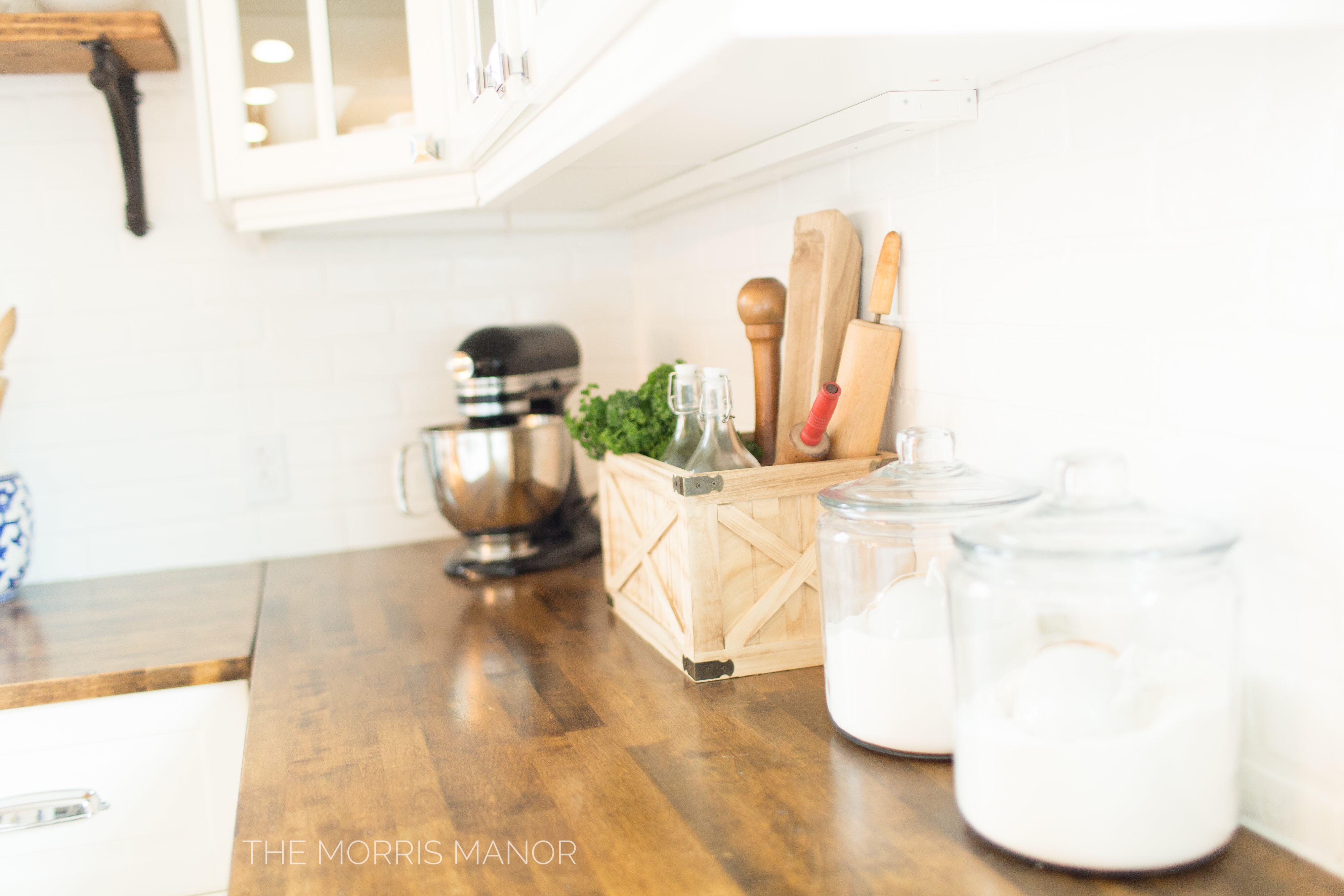 The Morris Manor Home Tour - Vintage White Farmhouse Kitchen, Warm Wood Counter Tops, Open Shelves, Cutting Boards and Crocks