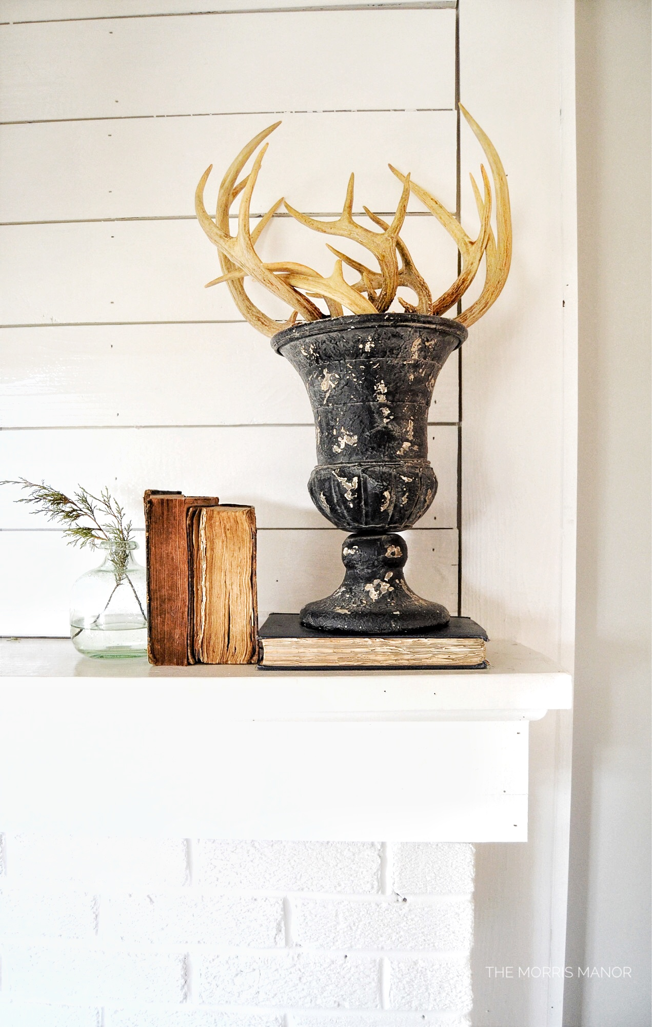 Vintage urn, antlers, fireplace, family room - The Morris Manor Farmhouse Home Tour