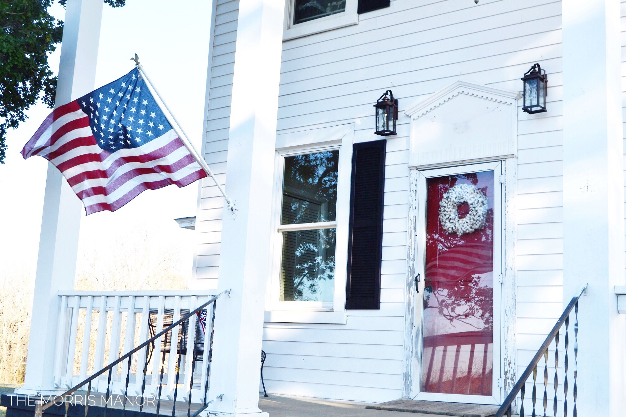 Farmhouse Front Porch, Red Door and American Flag - The Morris Manor Home Tour