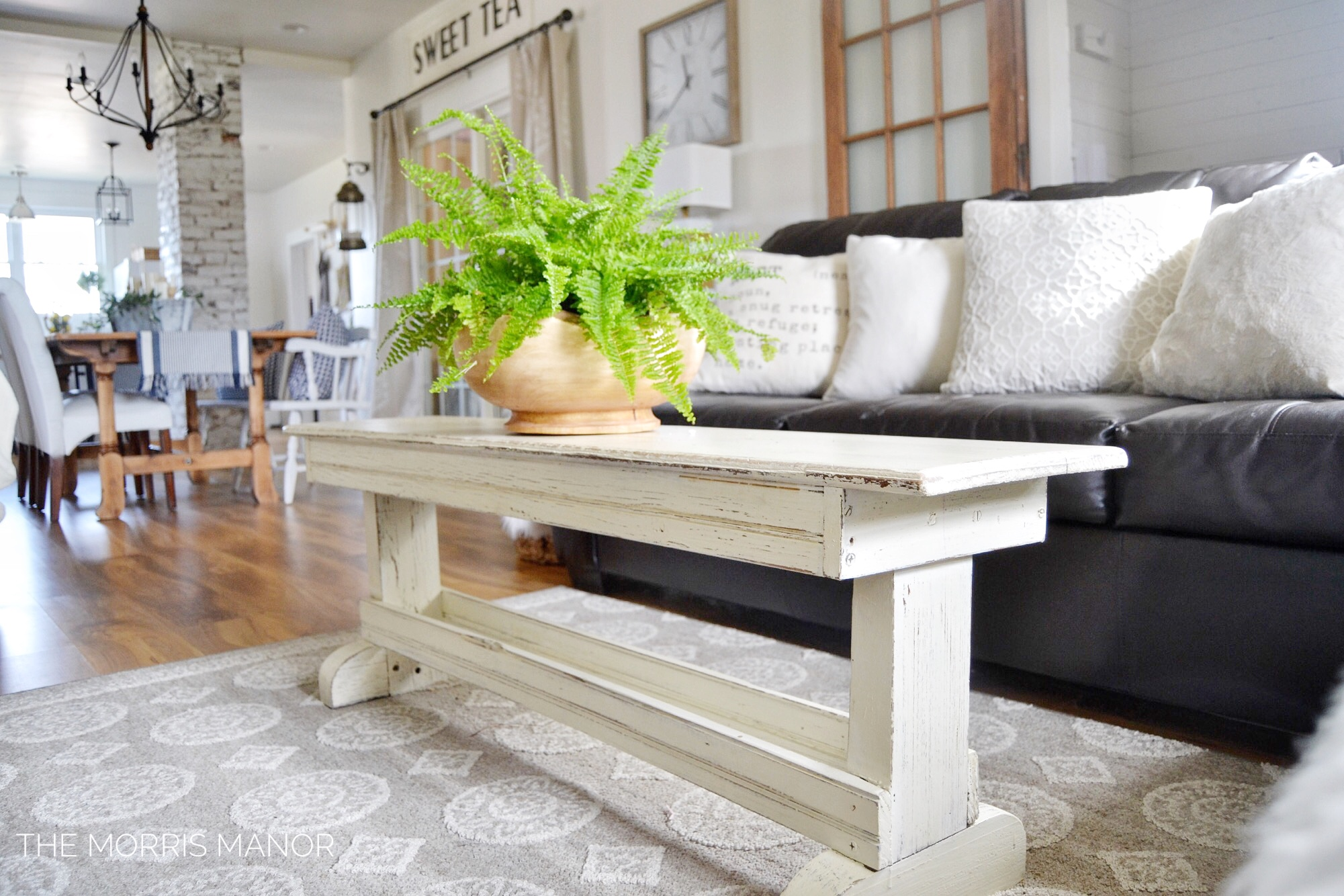 The Morris Manor Farmhouse Home Tour - Family Great Room - Vintage chippy white coffee table bench, potted fern